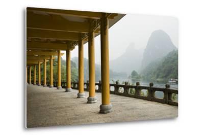 The Li River Runs Past a Covered Walkway by the Karst Formations-Jonathan Kingston-Metal Print