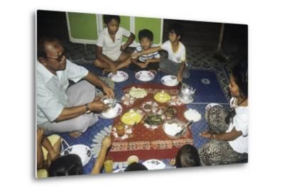 Malay Family Eating an Iftar Meal Following the End of the Day'S Fast During the Month of Ramadan--Metal Print