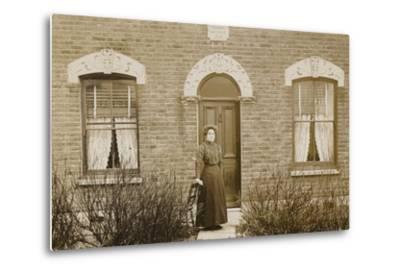 Woman Standing Outside Reuben Cottage--Metal Print