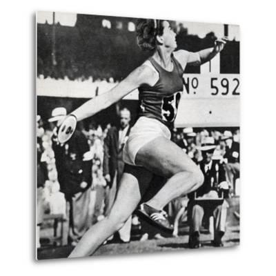 Olga Fikotova of Czechoslovakia Setting a New Olympic Record in the Final of the Women's Discus--Metal Print