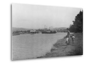 Woman and Children Watching a Ship at Waipu Wharf, C.1900--Metal Print