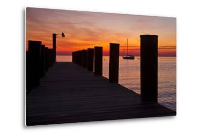 Sunrise on the Water with an Empty Dock and a Sailboat in the Distance of Tilghman Island, Maryland-Karine Aigner-Metal Print