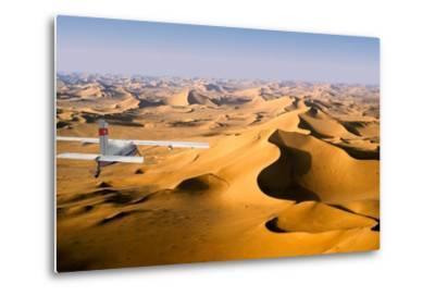Small Plane Flying Above Giant Sand Dunes in Morning Light, Grand Erg Oriental, Algeria--Metal Print