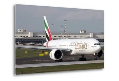 An Emirates Boeing 777 at Milano Malpensa Airport, Italy--Metal Print