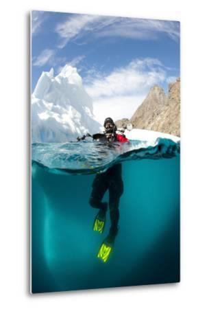 Diver in Front of an Iceberg, Astrolabe Island, Antarctic Peninsula, Antarctica--Metal Print