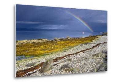 Rainbow Above Rocky Beach and Small Boat--Metal Print