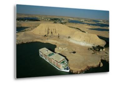 A Cruise Ship on Lake Nasser Near the Great Temple of Abu Simbel-Marcello Bertinetti-Metal Print