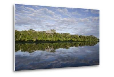 Clouds and Forested Coastline Reflected in Calm Water-Bertie Gregory-Metal Print