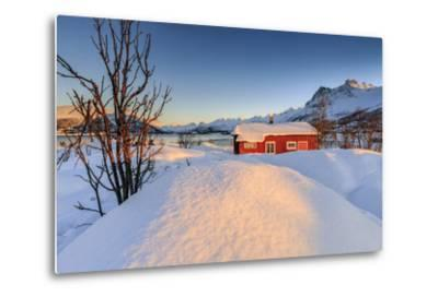 The Winter Sun Illuminates a Typical Norwegian Red House Surrounded by Fresh Snow-Roberto Moiola-Metal Print