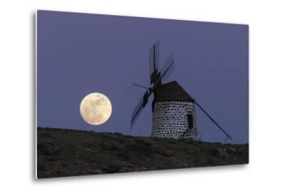 The Full Moon, and Wolf Moon, the First Full Moon after the Winter Solstice, over a Windmill-Babak Tafreshi-Metal Print