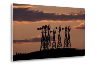 Silhouettes of Windmills Against the Sunset-Michael Forsberg-Metal Print