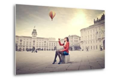Beautiful Woman In Colored Clothes On A Square With Hot-Air Balloon In The Background-olly2-Metal Print