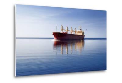 Cargo Ship Sailing in Still Water-aleksey.stemmer-Metal Print