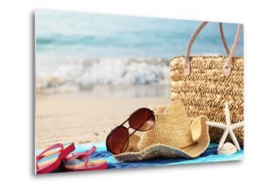 Summer Beach Bag with Straw Hat,Towel,Sunglasses and Flip Flops on Sandy Beach-Sofiaworld-Metal Print