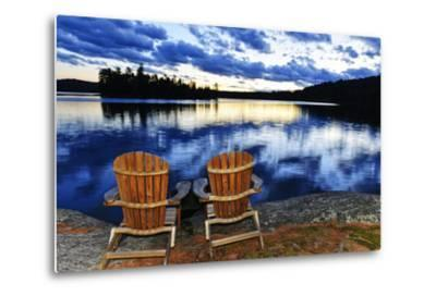 Landscape with Adirondack Chairs on Shore of Relaxing Lake at Sunset in Algonquin Park, Canada-elenathewise-Metal Print