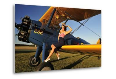 1940's Style Pin-Up Girl Sitting on the Wing of a Stearman Biplane--Metal Print