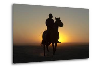 A Silhouetted Man on Horseback at Sunset-Beverly Joubert-Metal Print