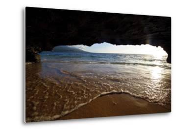 The Lip of a Foamy Wave Laps a Sandy Beach Inside an Ocean Cave-Jason Edwards-Metal Print
