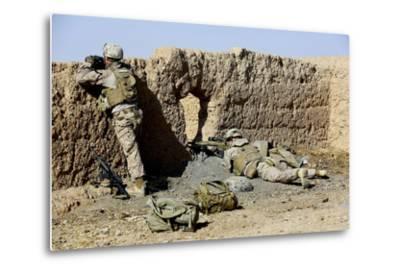 U.S. Marines Take Cover During a Patrol in Afghanistan--Metal Print