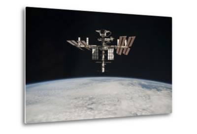 The International Space Station in Orbit Above Earth--Metal Print