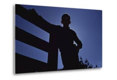 Silhouette of Boy Leaning Against Fence-William P^ Gottlieb-Metal Print