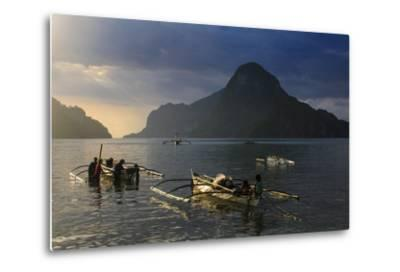 Outrigger Boat at Sunset in the Bay of El Nido, Bacuit Archipelago, Palawan, Philippines-Michael Runkel-Metal Print