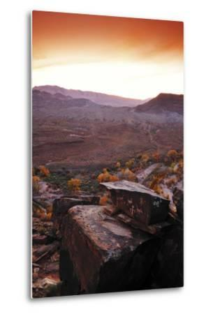 A Rock Covered in Petroglyphs in a Desert Landscape at Sunset-Keith Ladzinski-Metal Print