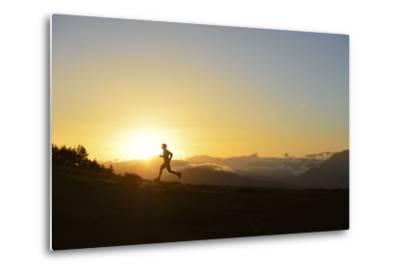 A Silhouetted Man Running Near the Verdon Gorge at Twilight-Keith Ladzinski-Metal Print