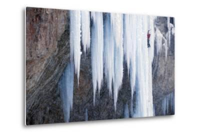 A Man Ice-Climbing an Ice Formation-Keith Ladzinski-Metal Print
