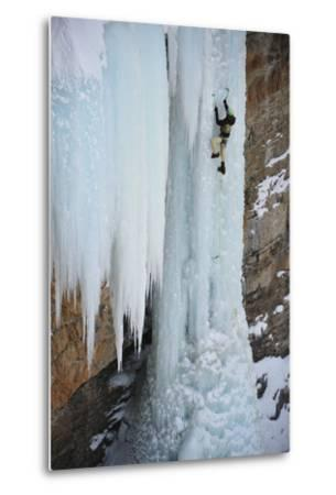A Man Ice-Climbing the Fang, an Ice Formation on the Side of a Cliff-Keith Ladzinski-Metal Print