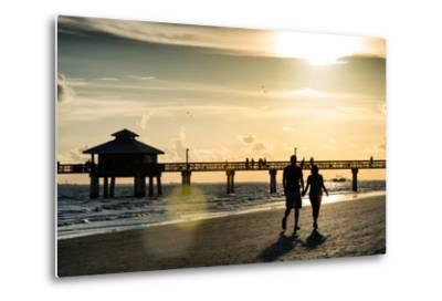 Loving Couple walking along the Beach at Sunset-Philippe Hugonnard-Metal Print