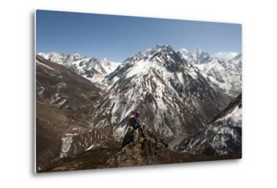 A Trekker Looks Out at the View of Ganesh Himal Mountains in Nepal-Alex Treadway-Metal Print