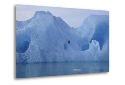 A Climber Navigates Tricky Terrain on a Blue Iceberg Off the Coast of Greenland-Keith Ladzinski-Metal Print