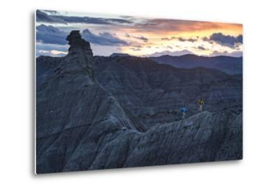 A Paleontologist and Volunteer Walk a Ridgeline in the Fossil Rich Badlands of Southern Utah-Cory Richards-Metal Print