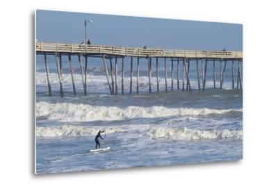 A Boy Paddles Out into Big Waves on His Standup Paddle Board Next to Nags Head Pier-Skip Brown-Metal Print