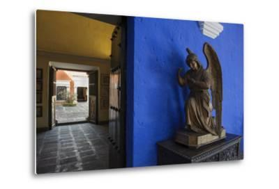 Carved Wooden Angels Guard a Hallway in the Restored 1730 Mansion Casa De Moral-Beth Wald-Metal Print