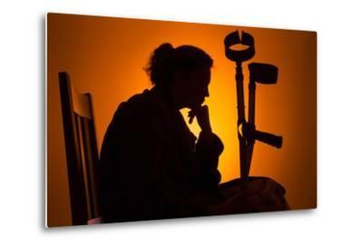 Woman Seated with Crutches-Anthony West-Metal Print
