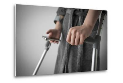 Person on Crutches Texting-Anthony West-Metal Print