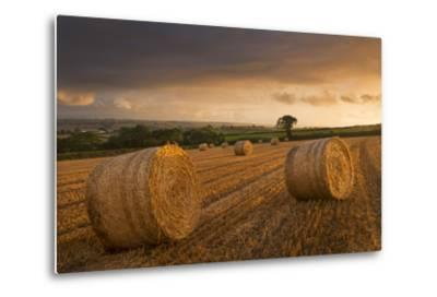 Hay Bales in a Ploughed Field at Sunset, Eastington, Devon, England. Summer (August)-Adam Burton-Metal Print