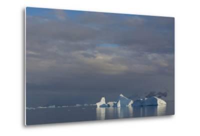 Antarctica. Gerlache Strait. Iceberg and Cloudy Skies-Inger Hogstrom-Metal Print