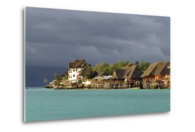 Tanzania, Zanzibar, Nungwi, Tourist Resort on Stilts-Anthony Asael-Metal Print