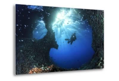 Scuba Diver Swimming through an Arch-Bernard Radvaner-Metal Print
