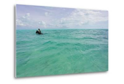 A Woman Riding a Horse in Turquoise Caribbean Waters, Near Shore-Mike Theiss-Metal Print
