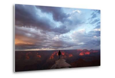 A Man Looking Out over the Grand Canyon at Sunrise from a Rock Promontory-Luis Lamar-Metal Print