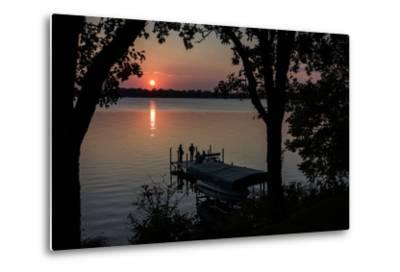 Residents Watch a Late Summer Sunset from their Dock on West Okoboji Lake-Kent Kobersteen-Metal Print