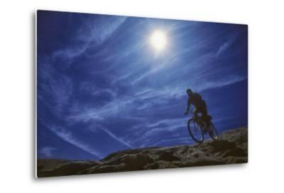 A Mountain Biker on Slickrock Trail Near Moab, Utah-David Hiser-Metal Print