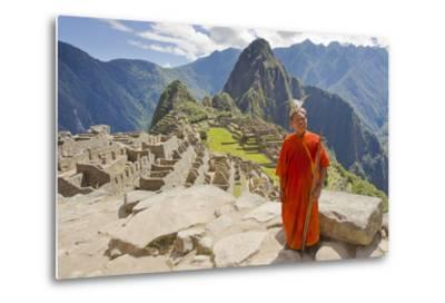 A Local Tribesman with a Spear Chants on a Cliff at Machu Picchu-Mike Theiss-Metal Print