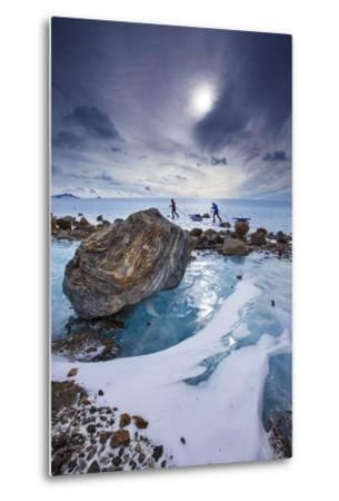Expedition team members trek over blue glacial ice.-Cory Richards-Metal Print