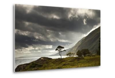 Sunlight Shingin Through the Storm Clouds over the Water Along the Coastline-Design Pics Inc-Metal Print