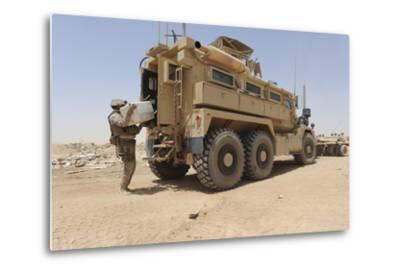 Hospital Corpsman Loads Up a Mine Resistant Ambush Protected Vehicle--Metal Print